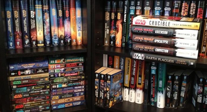 A fraction of my own half-organized Star Wars book collection. I Have Opinions about many of these, but I will spare you.